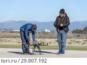 Professional drone being prepared by pilot assistant. Стоковое фото, фотограф Carlos Dominique / age Fotostock / Фотобанк Лори
