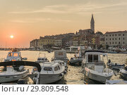 Купить «ROVINJ CROATIA ON AUGUST 19, 2018: Sunset in Rovinj medieval city in Istria Croatia.», фото № 29809548, снято 19 августа 2018 г. (c) age Fotostock / Фотобанк Лори