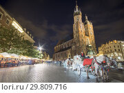Купить «KRAKOW POLAND ON SEPTEMBER 25, 2018: The market square with St Mary basilica by dusk.», фото № 29809716, снято 25 сентября 2018 г. (c) age Fotostock / Фотобанк Лори