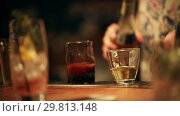 Купить «Bartender working. Mixing an alcoholic cocktail. Measuring amount of alcohol and adding an ingredient to the glass», видеоролик № 29813148, снято 18 июня 2019 г. (c) Константин Шишкин / Фотобанк Лори