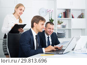 Купить «Two adult business male and woman in firm office», фото № 29813696, снято 17 сентября 2019 г. (c) Яков Филимонов / Фотобанк Лори