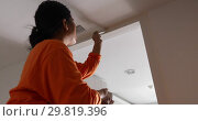 Купить «Woman Painting the Edges of the Ceiling with Paintbrush», видеоролик № 29819396, снято 29 января 2019 г. (c) Ekaterina Demidova / Фотобанк Лори