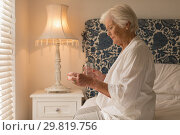 Купить «Senior woman having medicine in bedroom», фото № 29819756, снято 6 ноября 2018 г. (c) Wavebreak Media / Фотобанк Лори