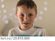 Купить «Innocent boy sitting in bedroom at home», фото № 29819880, снято 6 ноября 2018 г. (c) Wavebreak Media / Фотобанк Лори