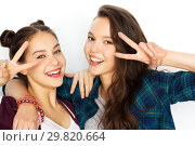 Купить «happy teenage girls hugging and showing peace sign», фото № 29820664, снято 19 декабря 2015 г. (c) Syda Productions / Фотобанк Лори