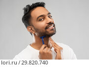 Купить «indian man shaving beard with razor blade», фото № 29820740, снято 27 октября 2018 г. (c) Syda Productions / Фотобанк Лори