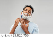 Купить «indian man shaving beard with razor blade», фото № 29820756, снято 27 октября 2018 г. (c) Syda Productions / Фотобанк Лори