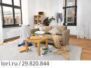 Купить «interior of messy home room with scattered stuff», фото № 29820844, снято 7 декабря 2018 г. (c) Syda Productions / Фотобанк Лори