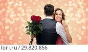 Купить «woman with engagement ring and roses hugging man», фото № 29820856, снято 30 ноября 2018 г. (c) Syda Productions / Фотобанк Лори