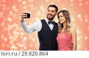 Купить «happy couple taking selfie by smartphone», фото № 29820864, снято 30 ноября 2018 г. (c) Syda Productions / Фотобанк Лори