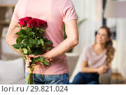 Купить «woman and man with bunch of roses behind his back», фото № 29821024, снято 30 ноября 2018 г. (c) Syda Productions / Фотобанк Лори