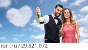 Купить «happy couple with bottle of champagne and glasses», фото № 29821072, снято 30 ноября 2018 г. (c) Syda Productions / Фотобанк Лори