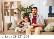 Купить «happy father and daughter watching tv at home», фото № 29821208, снято 4 ноября 2018 г. (c) Syda Productions / Фотобанк Лори