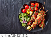 chicken kebab grilled on skewers, flat lay. Стоковое фото, фотограф Oksana Zh / Фотобанк Лори