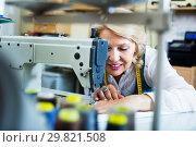 Купить «Tailor using sewing machine», фото № 29821508, снято 20 июля 2019 г. (c) Яков Филимонов / Фотобанк Лори