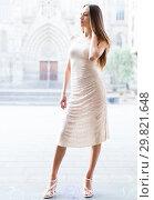 Купить «portrait of young female in sexually ivory midi gown standing in town», фото № 29821648, снято 24 июня 2017 г. (c) Яков Филимонов / Фотобанк Лори