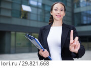 Купить «Female office manager is asking companion to wait», фото № 29821668, снято 26 июня 2017 г. (c) Яков Филимонов / Фотобанк Лори