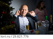 Купить «Quarrel of wife and husband at the Christmas table», фото № 29821776, снято 10 января 2019 г. (c) Яков Филимонов / Фотобанк Лори