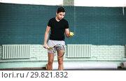 Купить «Training on the tennis court. Young man hitting the ball from the floor», видеоролик № 29821832, снято 20 ноября 2019 г. (c) Константин Шишкин / Фотобанк Лори