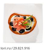 Купить «Tasty canape with salmon and olives», фото № 29821916, снято 27 марта 2019 г. (c) Яков Филимонов / Фотобанк Лори