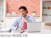 Купить «Young handsome employee working in the office», фото № 29825116, снято 11 сентября 2018 г. (c) Elnur / Фотобанк Лори