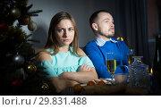 Купить «Unhappy couple celebrating New Year», фото № 29831488, снято 15 января 2019 г. (c) Яков Филимонов / Фотобанк Лори