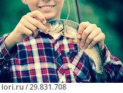 Купить «Teenager boy looking at fish on hook», фото № 29831708, снято 20 марта 2019 г. (c) Яков Филимонов / Фотобанк Лори