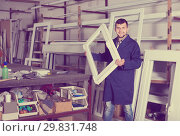 Купить «hardworking male professional labours with finished PVC profiles and windows», фото № 29831748, снято 30 марта 2017 г. (c) Яков Филимонов / Фотобанк Лори