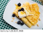 Купить «Crepes with brie and honey», фото № 29831908, снято 9 июля 2020 г. (c) Яков Филимонов / Фотобанк Лори