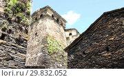 Купить «Svan towers in Ushguli, highest inhabited village in Europe. Caucasus, Upper Svaneti Georgia», видеоролик № 29832052, снято 31 января 2019 г. (c) Mikhail Starodubov / Фотобанк Лори