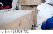 Купить «Construction site. Fastening the cargo. Checking the tension», видеоролик № 29839732, снято 27 марта 2019 г. (c) Константин Шишкин / Фотобанк Лори