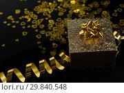 Купить «Valentine gift on black background», фото № 29840548, снято 11 октября 2018 г. (c) Wavebreak Media / Фотобанк Лори