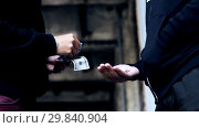 Купить «addict buying dose from drug dealer on street», видеоролик № 29840904, снято 19 марта 2019 г. (c) Syda Productions / Фотобанк Лори