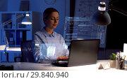 Купить «businesswoman with laptop and virtual screen», видеоролик № 29840940, снято 18 февраля 2019 г. (c) Syda Productions / Фотобанк Лори