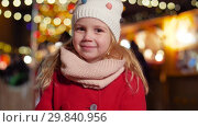 Купить «portrait of happy little girl at christmas market», видеоролик № 29840956, снято 12 января 2019 г. (c) Syda Productions / Фотобанк Лори