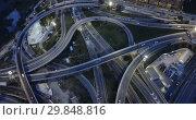 Купить «Aerial view of modern city highway grade separation in night lights», видеоролик № 29848816, снято 26 октября 2018 г. (c) Яков Филимонов / Фотобанк Лори