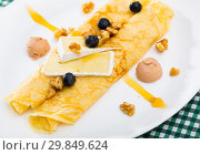 Купить «Pancakes with brie cheese a», фото № 29849624, снято 9 июля 2020 г. (c) Яков Филимонов / Фотобанк Лори