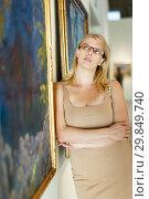 Купить «Woman visiting exposition of museum», фото № 29849740, снято 22 сентября 2018 г. (c) Яков Филимонов / Фотобанк Лори