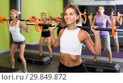 Купить «athletic girls during workout in gym with barbell», фото № 29849872, снято 26 июля 2017 г. (c) Яков Филимонов / Фотобанк Лори