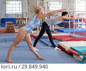 Купить «Fitness couple doing exercises in gym», фото № 29849940, снято 18 июля 2018 г. (c) Яков Филимонов / Фотобанк Лори