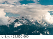 Beautiful landscape of peaks of the Caucasus Mountains and clouds. Стоковое фото, фотограф Володина Ольга / Фотобанк Лори