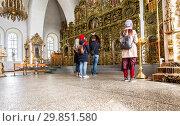 Купить «Orthodox Christians inside the Holy Trinity Cathedral», фото № 29851580, снято 10 июня 2018 г. (c) FotograFF / Фотобанк Лори