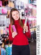 Купить «Female choosing hair combs in store», фото № 29851856, снято 22 марта 2018 г. (c) Яков Филимонов / Фотобанк Лори