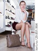 Купить «Portrait of smiling female customer who is posing with handbag», фото № 29851904, снято 13 декабря 2017 г. (c) Яков Филимонов / Фотобанк Лори