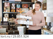 Купить «cheerful woman buyer holding wooden suitcase in furniture shopping room», фото № 29851924, снято 15 ноября 2017 г. (c) Яков Филимонов / Фотобанк Лори