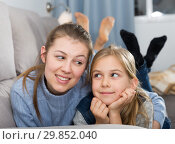 Купить «Happy mother with little daughter on the couch», фото № 29852040, снято 22 января 2019 г. (c) Яков Филимонов / Фотобанк Лори