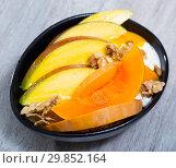 Купить «Sweet pumpkin and mango and whipped cream with oat-flakes at plate», фото № 29852164, снято 23 марта 2019 г. (c) Яков Филимонов / Фотобанк Лори