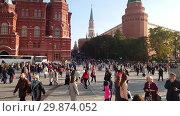 Купить «Moscow, Russia - October 7. 2018. Many tourists at the Manezhnaya Square near the Kremlin», видеоролик № 29874052, снято 3 февраля 2019 г. (c) Володина Ольга / Фотобанк Лори