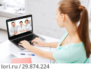 Купить «woman or student having video interview on laptop», фото № 29874224, снято 1 июня 2013 г. (c) Syda Productions / Фотобанк Лори
