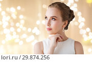 Купить «woman in white dress with diamond earring», фото № 29874256, снято 14 апреля 2016 г. (c) Syda Productions / Фотобанк Лори